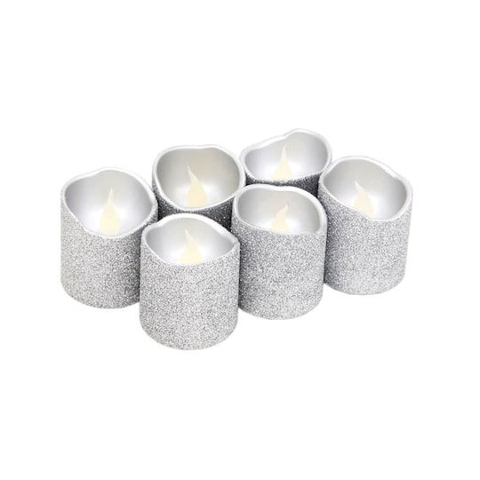 Find the Glitter LED Votive Candles by Ashland® at Michaels