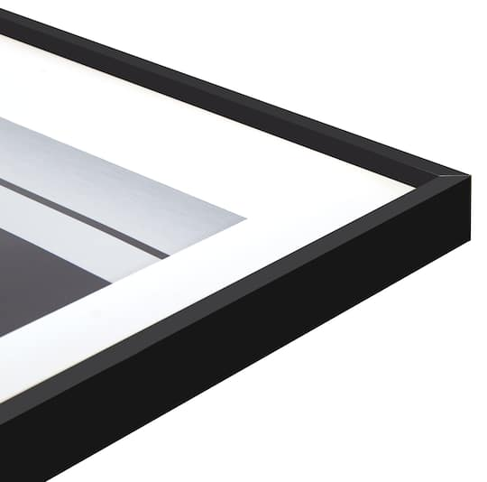 Find the Nielsen® Alpha Black Aluminum Matted Picture Frame at Michaels