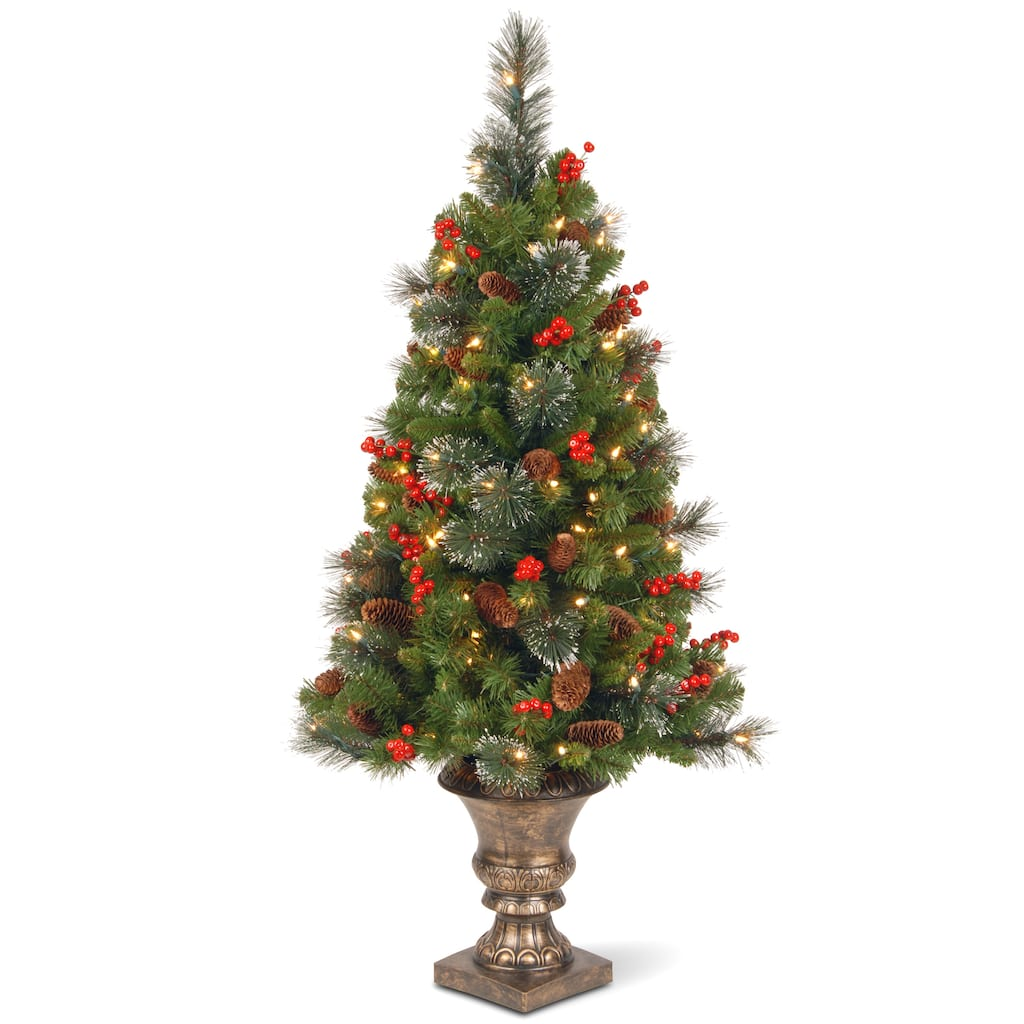 pre lit pre decorated potted crestwood spruce slim artificial christmas tree clear lights